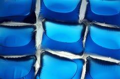 Washing capsules. Cloe-up of blue washing capsules Royalty Free Stock Photo