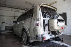 Washing of car. Car is in auto washing Stock Image