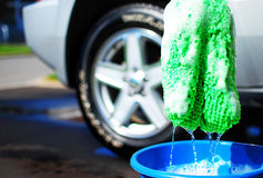 Washing the Car. Image of a car that has just been washed with the tools of the trade Royalty Free Stock Image
