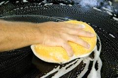 Washing Car. Male hand washing a black car Stock Photography