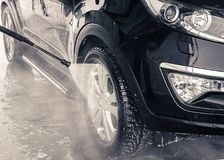 Washing car. Close up. High Pressure Water. Washing car. Manual car washing. Close up. High Pressure Water jet stock photography