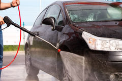 Washing a car with pressure washer stock photo