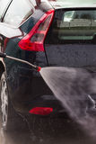 Washing a car with pressure washer Stock Images
