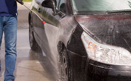Washing a car with pressure washer Stock Photos