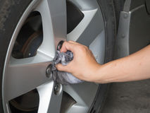 Washing car's alloy wheels Stock Images