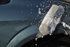 Washing Car with Scrub Brush Stock Photo