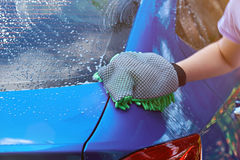 Washing car service. Wet modern car ready for washing Royalty Free Stock Images