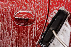 Cleaning the car at jetwash Royalty Free Stock Photography