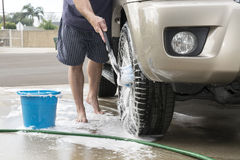 Washing car tires Stock Photos