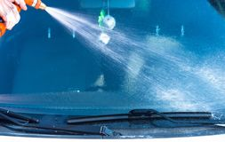 Washing a car with water Stock Photos