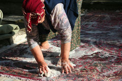 Washing the carpet. An old lady washing the carpet, working woman Stock Photo