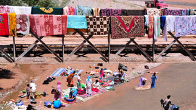 Washing carpets in Morocco Royalty Free Stock Images
