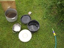 Washing casseroles outdoor