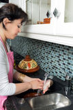 Washing chicken for tajine Stock Photos