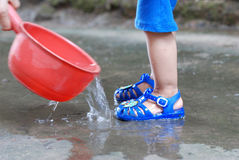 Washing childrens feet Royalty Free Stock Images