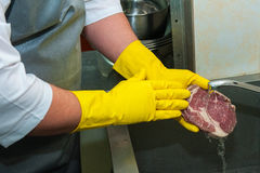 Washing and cleaning meat Stock Image