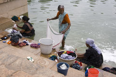 Washing clothes - Chettinad -Tamil Nadu - India. Local women washing clothes in the village of Karaikudi in the Chettinad area of the Tamil Nadu region of Royalty Free Stock Images