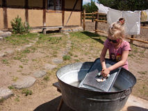 Washing clothes in old way stock image