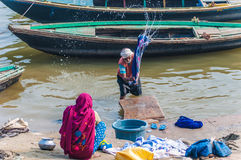Washing clothes in the river Ganges Royalty Free Stock Photography