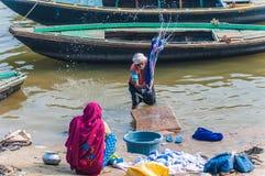 Washing clothes in the river Ganges. Varanasi, Uttar Pradesh, India royalty free stock photography