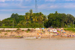 Washing clothes on the river Irrawaddy, Mandalay, Myanmar, Burma. Copy space for text. Royalty Free Stock Photos
