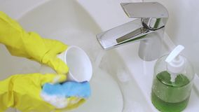 Washing cup stock video footage