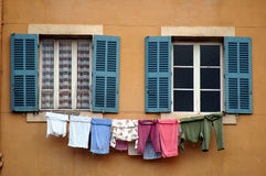Washing day. A clothesline at a window in marseille, france Stock Images