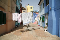 Washing day Burano. Colorful houses on the island of Burano in the Venetian lagoon - Italy Royalty Free Stock Image