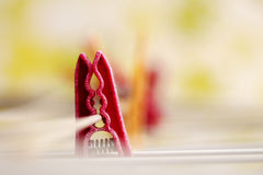 Washing day. Red clothespin on a clothesline Royalty Free Stock Photo