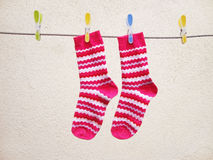 Washing day, Socks drying on a string. Photo of socks with pink pattern drying on a string Royalty Free Stock Photography