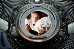 Washing the dirty clothes Stock Photos