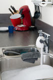 Washing the dishes Stock Images