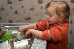 Washing the dishes royalty free stock image