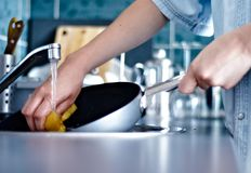 Washing the dishes Royalty Free Stock Images
