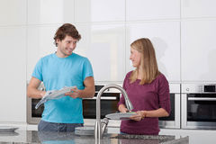 Washing dishes Stock Photos