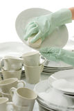 Washing dishes - hands with gloves in kitchen Stock Photography