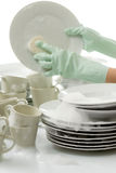 Washing dishes - hands with gloves in kitchen Stock Images