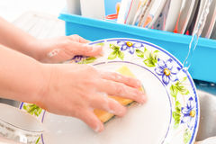 Washing the dishes on the kitchen sink Royalty Free Stock Photos