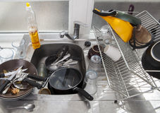 Washing dishes on a kitchen Stock Image