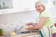 Washing the Dishes Royalty Free Stock Photography