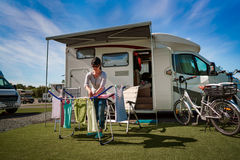 Washing on a dryer at a campsite. Caravan car Vacation. Family vacation travel, holiday trip in motorhome stock photo