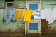 Washing drying in front of shack Stock Photography