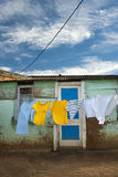 Washing drying in front of shack Stock Photos