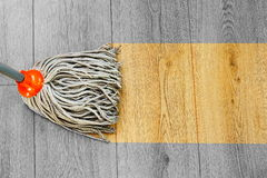 Washing dust on wooden floor with mop Stock Photo