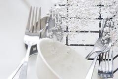 Washing flatware Stock Image