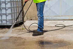 Washing the floor. Worker washing the floor in a industrial site Royalty Free Stock Image