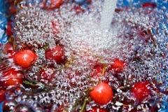 Washing fresh cherries Stock Photos