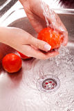 Washing fresh vegetables Royalty Free Stock Images