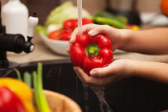 Washing fresh vegetables for a healthy salad - the red bell pepp Royalty Free Stock Photo