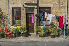 Washing in front of house Royalty Free Stock Photo
